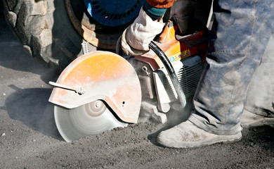 Cutting road works with petrol driven angle grinder