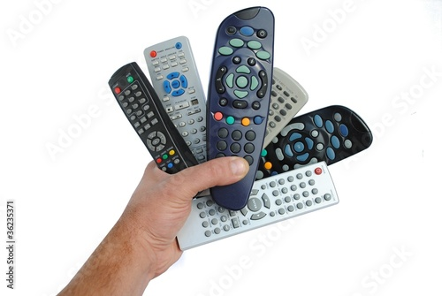 man hand holds six remote control, isolated on white