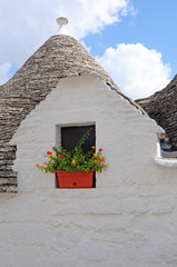 Trulli with flowers in Alberobello, Italy