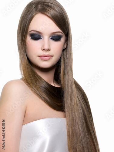 Woman with eye make-up and long hair
