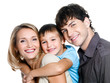 Portrait of happy young smiling family with child