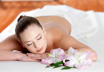 woman joing and relaxing in spa salon