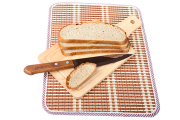 Slices of bread  knife chopping board isolated