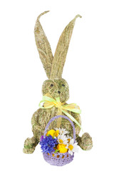 Rabbit with a basket of hay toy isolated on white background
