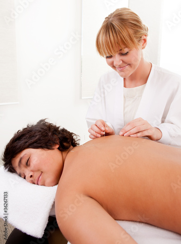 Acupuncturist with Young Male Patient