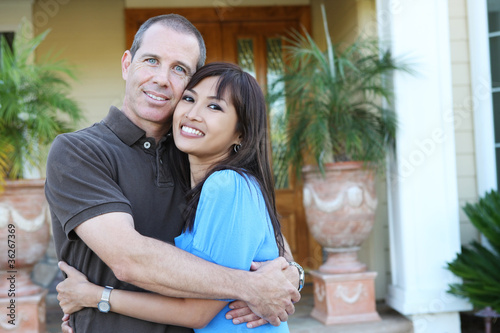 Diverse couple at home