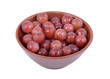 Red Grapes in a bowl, isolated on a white background