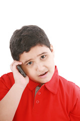 Young boy talking to cell phone, isolated on white background.
