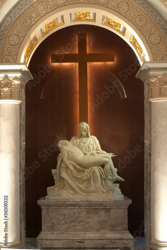 The mother'of God and Crucifix in church .