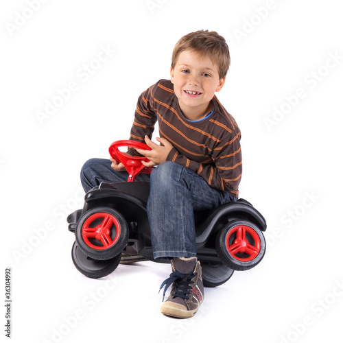 young little boy playing with his car