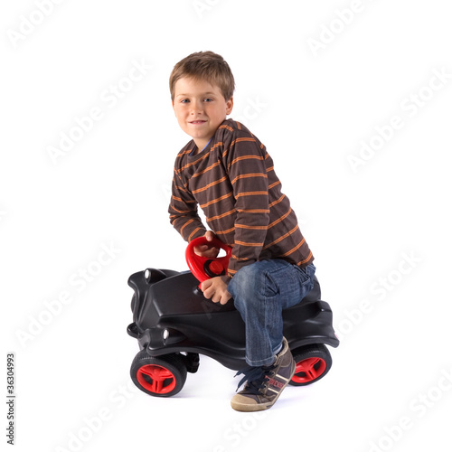 young little boy driving his car