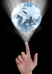 concept hand pointing a glowing earth globe and email