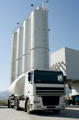 Cement factory with silos and mixer truck