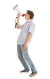 screamimg young man holding megaphone, white background