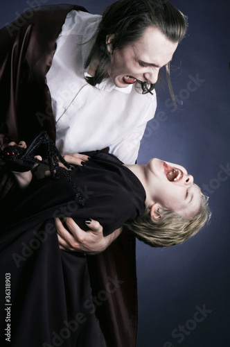 Adult vampire and his young victim