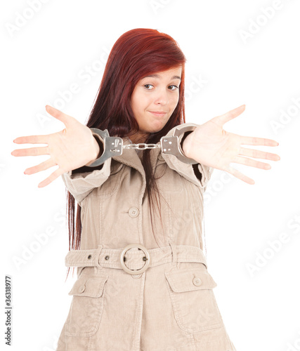 standing young woman in handcuffs, white background