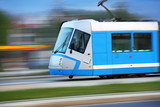 Modern  blue tram rider fast on rails, Wroclaw, Poland