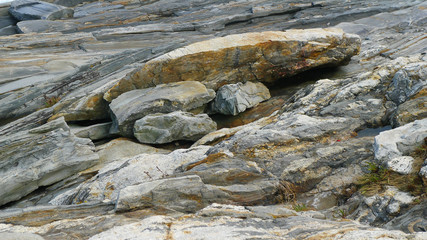 Massive weathered granite rocks on the coast of maine at low tid