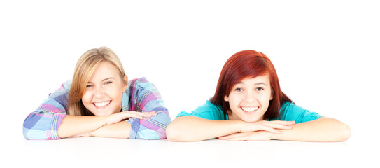 two teenage girls, friends on the white background