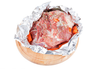 Meat prepared for roasting in a foil