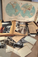 Old books,albums,photos,postcards and letters and atlas.