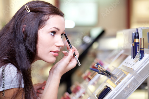 Young woman testing cosmetics. Selective focus.