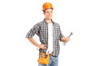 A confident and smiling handyman holding a wrench