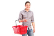 A man holding an empty shopping basket