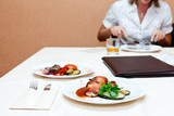 Roast meat on table. Unrecognizable person eating poster