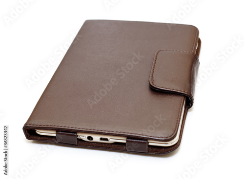 E-book in brown leather closed isolated on white background