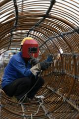 workers in bridge construction site