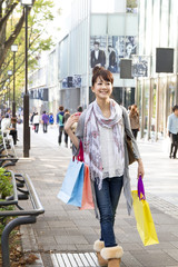 Asian shopping woman in town