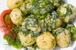 Potatoes and tomatoes with herbs