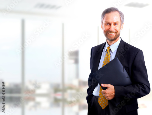 Portrait of a happy successful mature business