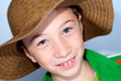 smiling child with straws hat