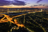 Vienna at night with Danube River & Island and highway junction poster