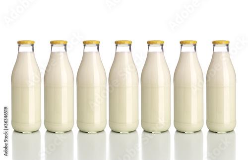 Leinwandbild Motiv Milchflaschen
