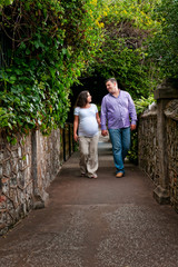 Couple expecting a baby walking holding hands