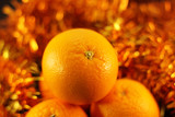 orange close up on a background of twinkling garlands poster