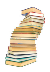 a large stack of books on white background