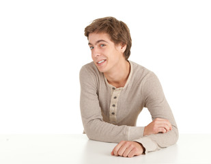 young man leaning on table, white background