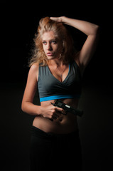 Beautiful woman with pistol