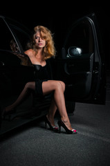 Beautiful woman going out of car