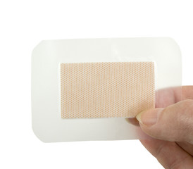 holding a waterproof clear bandage on a white background