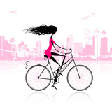 Fototapety Girl cycling in the city