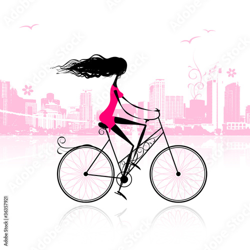 Girl cycling in the city © Kudryashka