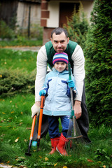 Father and daughter working in the autumn garden