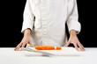 Chef cutting carrots