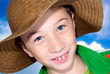 child with straw hat and blue sky