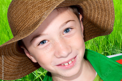 child with hat and ear